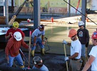 Independence Excavating employees working on the concrete flooring for the melt shop